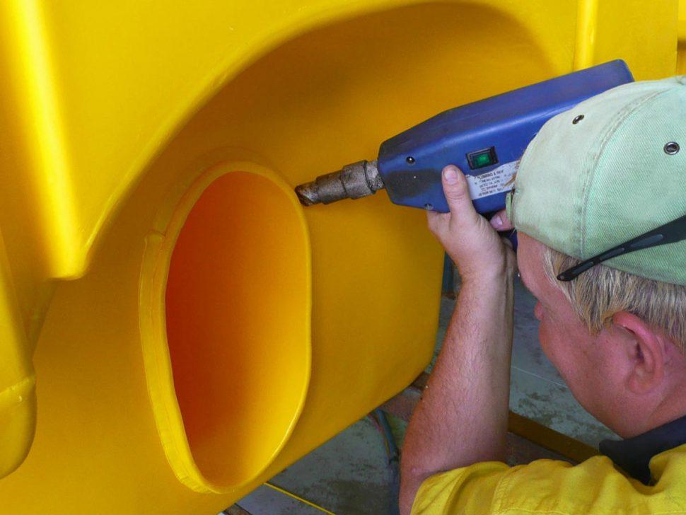 Man Drilling Plastic Product