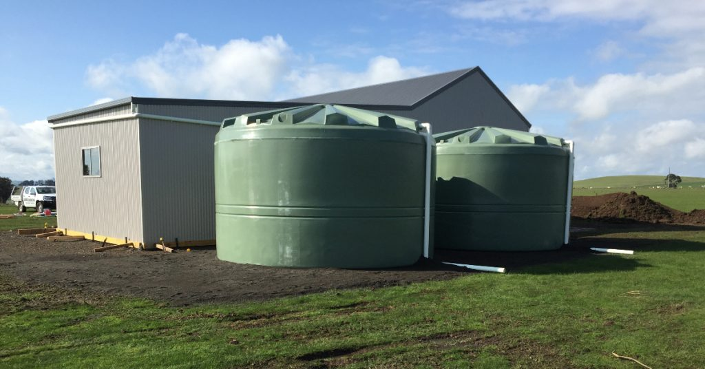 Two Large Green Water Tanks